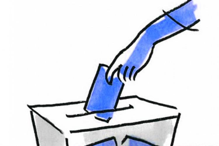 Disegno di mano che mette il proprio voto all'interno della cassetta elettorale